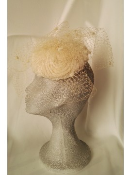 Headdress with sinamay base and domed broken white